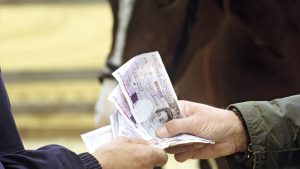 Exchanging money, buying a horse, sales, deals, sold, twenty pound notes