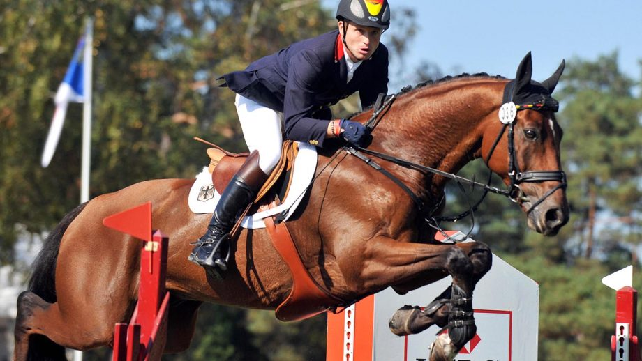 German Michael Jung (third placed) jumps with Sam on September 27, 2009 in Fontainebleau, east of Paris, during the European Equestrian jumping championship. AFP PHOTO MIGUEL MEDINA (Photo credit should read MIGUEL MEDINA/AFP/Getty Images)