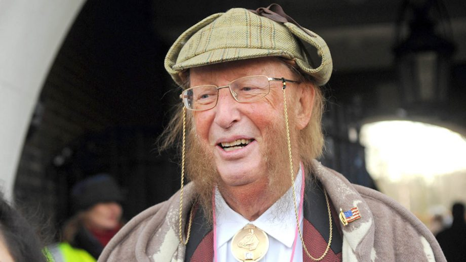 ECGDXE London, UK. 14th December, 2014. John McCririck teaches tic tac before pantomime horse race. Greenwich Village annual sci-fi parade and pantomime horse race. Credit: JOHNNY ARMSTEAD/Alamy Live News