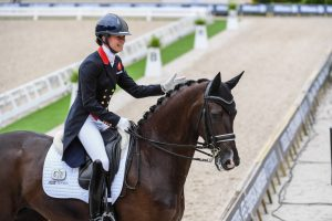 Lottie Fry leaves the Rotterdam arena on Dark Legend after their grand prix test at the European Championships