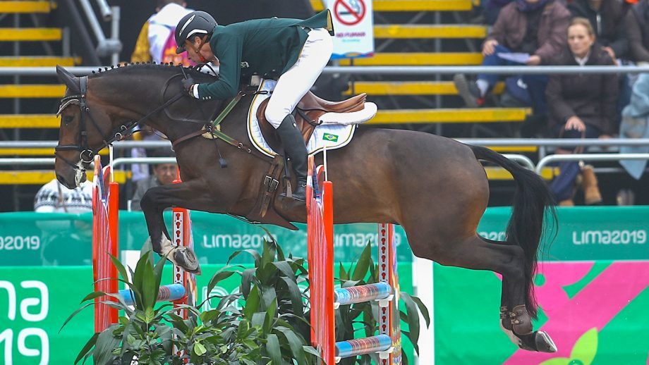 LIMA, PERU - AUGUST 04: Marcelo Tosi of Brazil rides Starbucks during Equestrian Eventing Individual - Jumping Final at Army Equestrian School on Day 9 of Lima 2019 Pan American Games on August 4, 2019 in Lima, Peru. (Photo by Daniel Apuy/Getty Images for FEI)