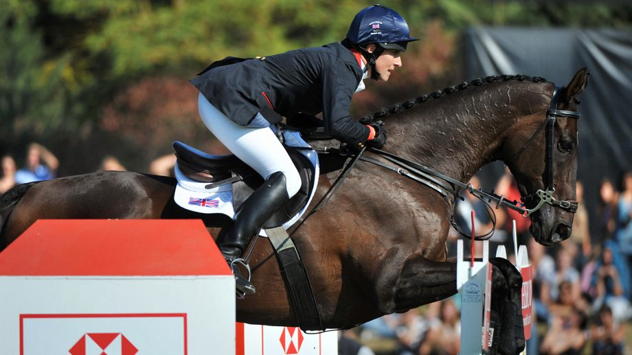 British Kristina Cook jumps with Miners Frolic on September 27, 2009 in Fontainebleau, east of Paris, before winning the European Equestrian jumping championship. AFP PHOTO MIGUEL MEDINA (Photo credit should read MIGUEL MEDINA/AFP/Getty Images)