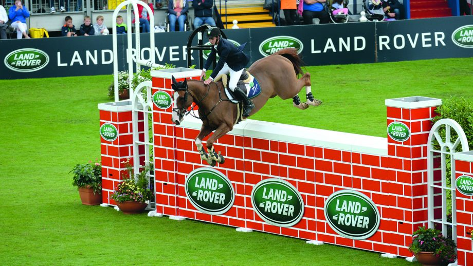 Christopher MEGAHEY (IRL) riding Seapatrick Cruise Cavalier, joint winner of Land Rover Puissance (International Comp 10) during Dublin Horse Show, in the Royal Dublin Society showground in Dublin in Ireland between 9 - 13th August 2017