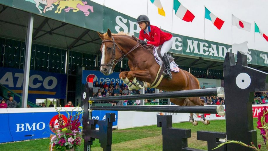 Beezie Madden jumping at Spruce Meadows