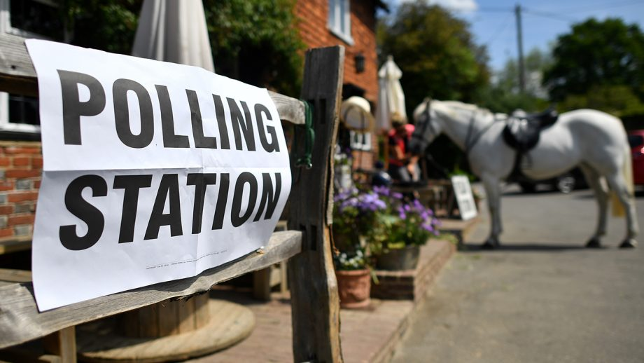 A voter sits with her horse after riding to a polling station, set up in a pub, to vote in the European Parliament elections, near Tonbridge, south east England, on May 23, 2019. - Voting got under way in Britain early on Thursday in elections to the European Parliament -- a contest the country had not expected to hold nearly three years after the Brexit referendum. (Photo by Ben STANSALL / AFP) (Photo credit should read BEN STANSALL/AFP via Getty Images)