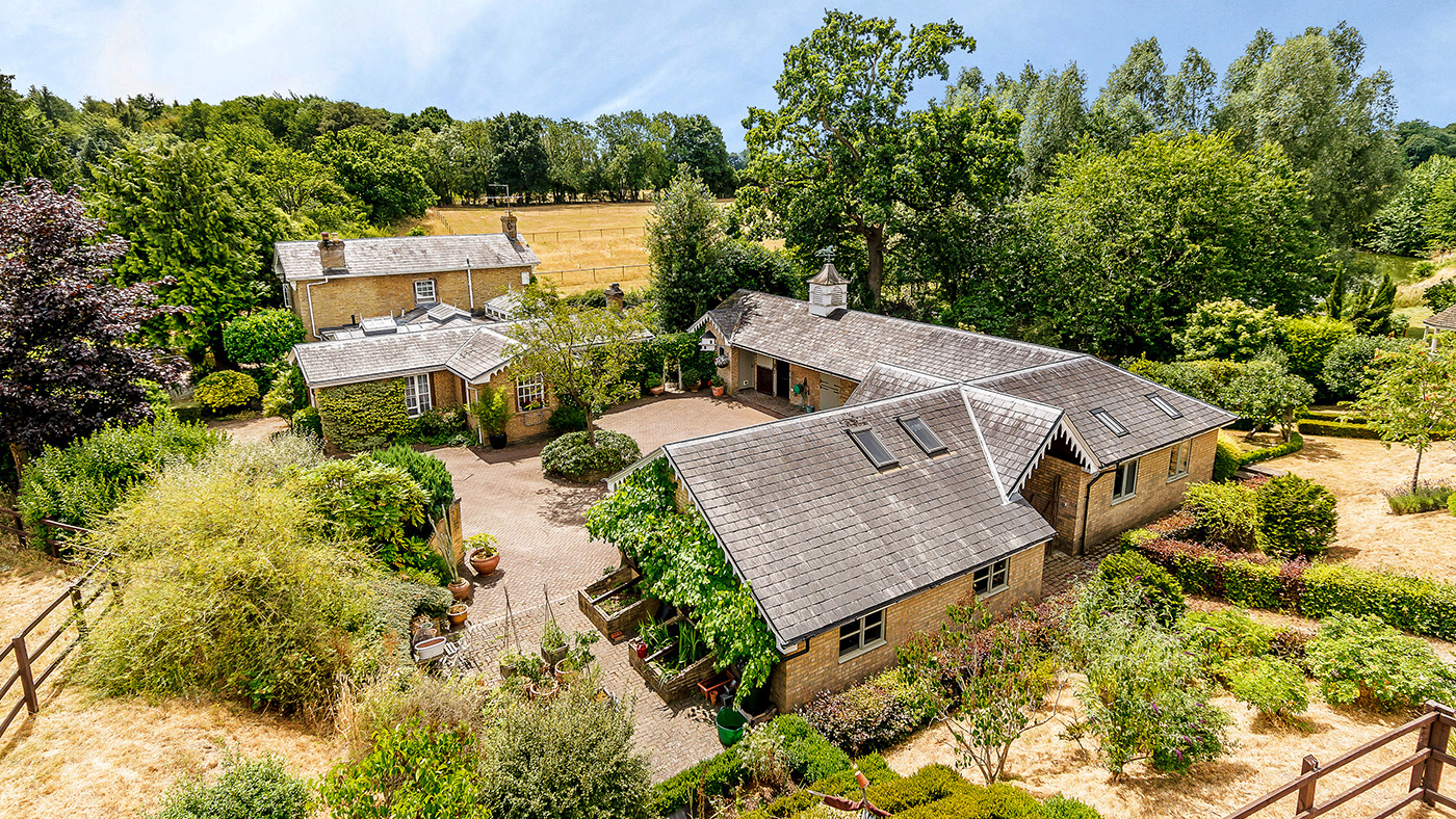 Want your horses on your doorstep? Check out this stunning Grade II property with private lake and stables