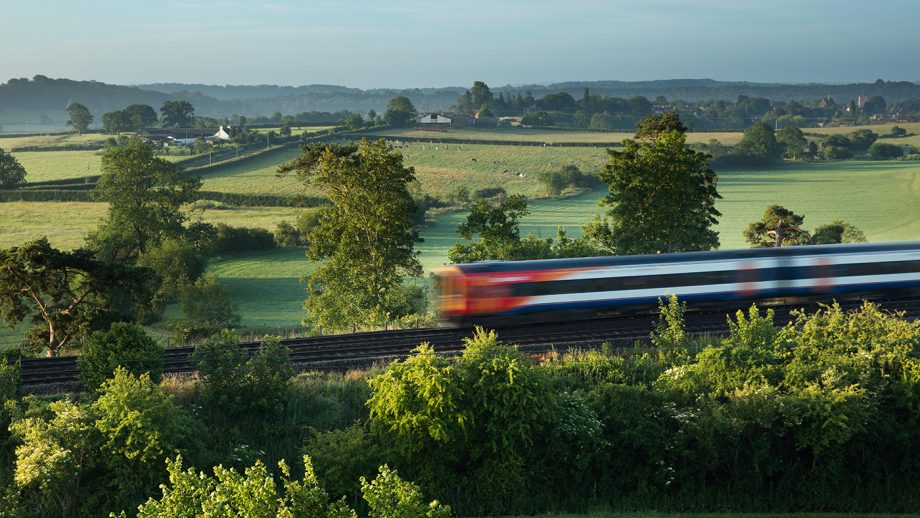 A fast train cutting through British countryside