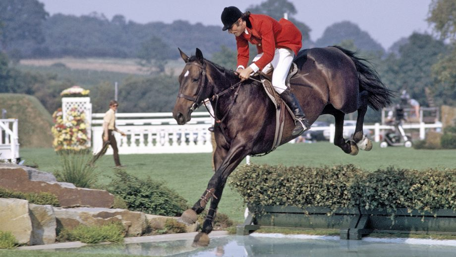 Graham Fletcher of Great Britain riding Tauna Dora over a jump during the Wills Castella Stakes at Hickstead on 16th August 1973. (Photo by Ed Lacey/Popperfoto/Getty Images)