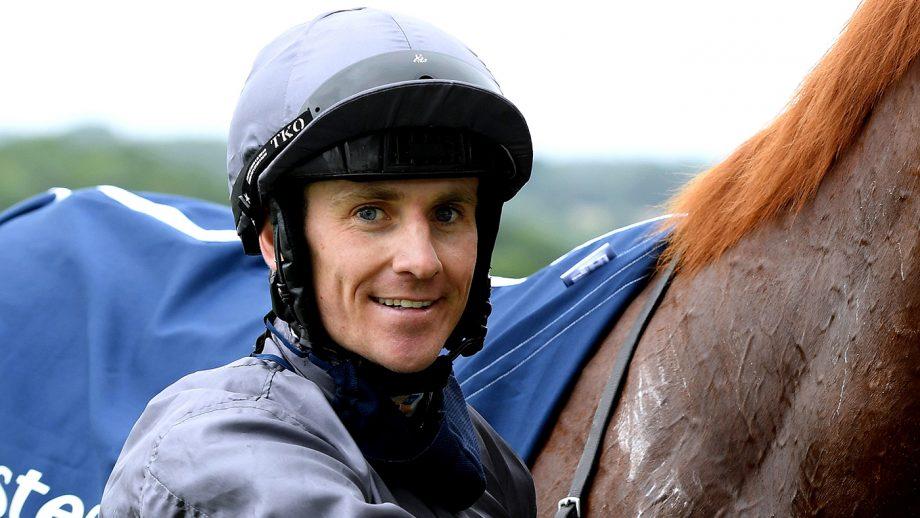 Jockey Emmet McNamara celebrates with Serpentine after winning the Investec Derby at Epsom Racecourse.