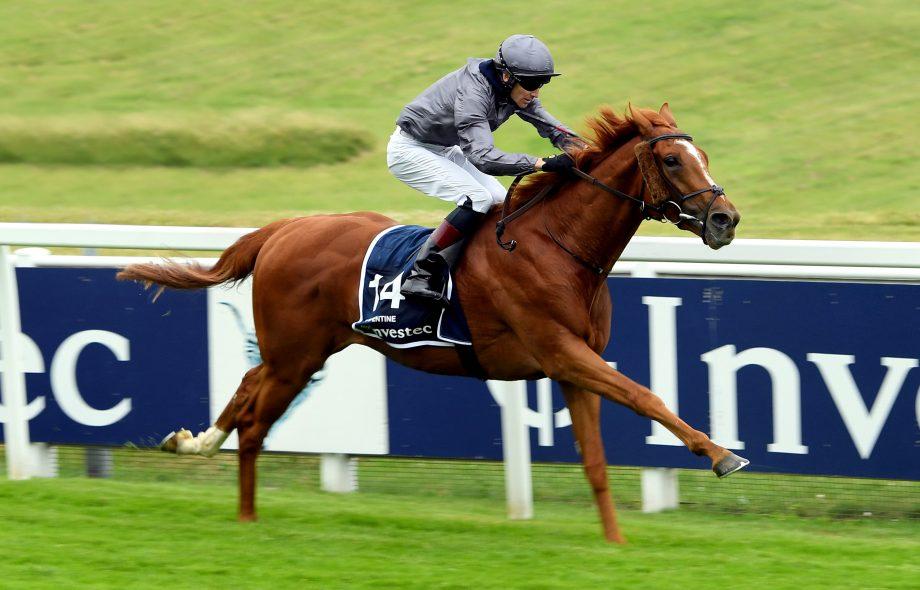 Serpentine ridden by jockey Emmet McNamara wins the Investec Derby at Epsom Racecourse.