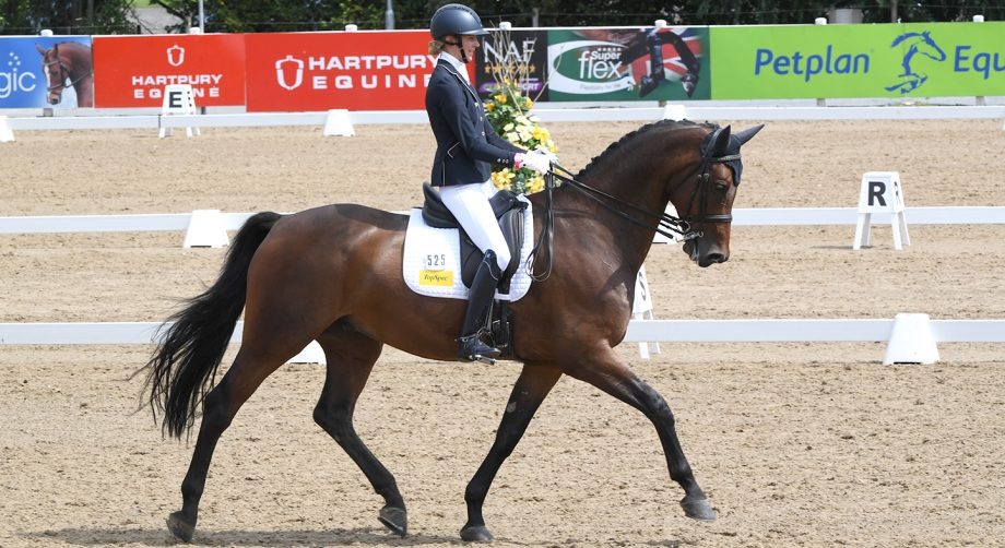 Kate Cowell and Rayban on their way to winning the advanced medium gold at the Winter Dressage Championships 2020