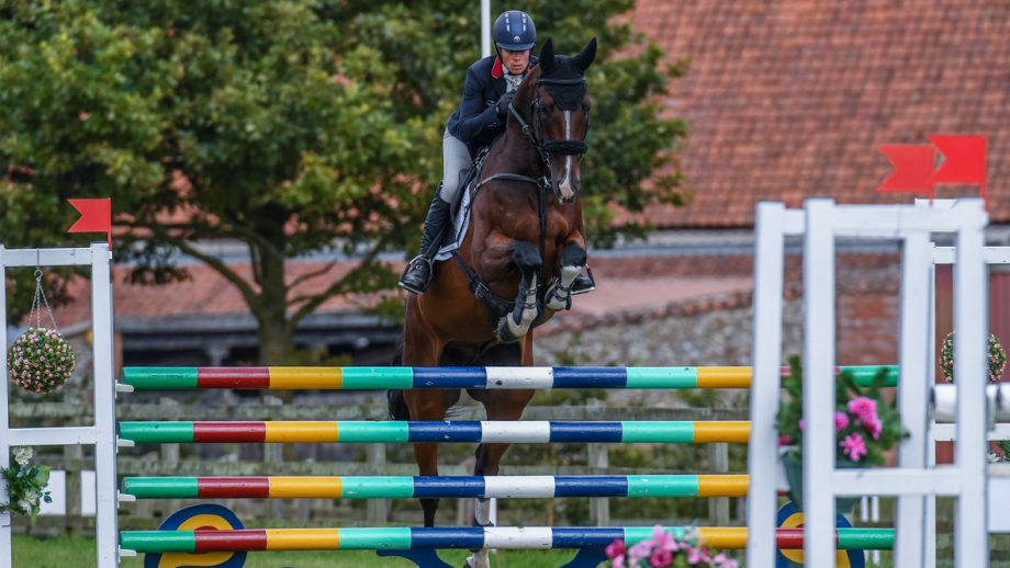 Izzy Taylor and Monkeying Around showjumping clear to win the Burnham Market CCI4*-L in September 2020.