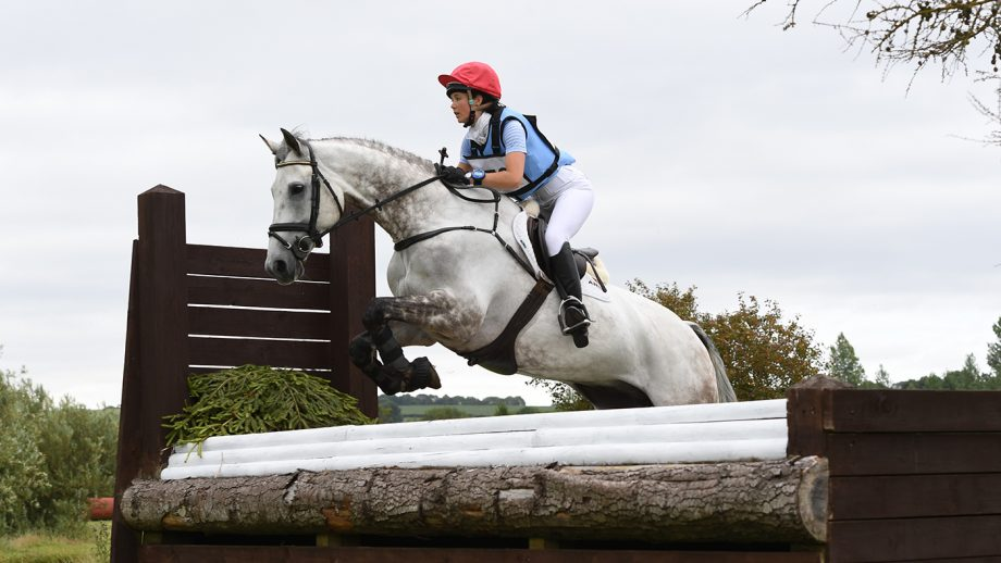 Charlotte Agnew pilots Jacobite across country in a Fairfax eventing breastplate