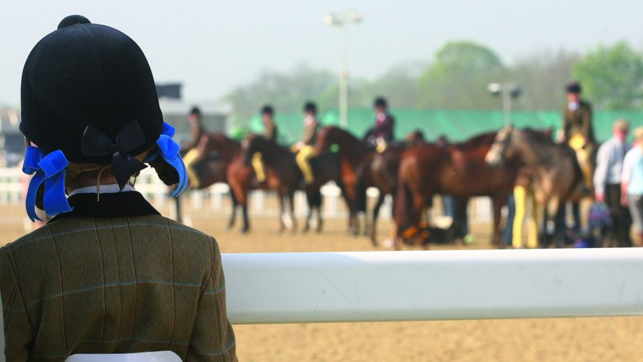 Young competitor watches a showing class