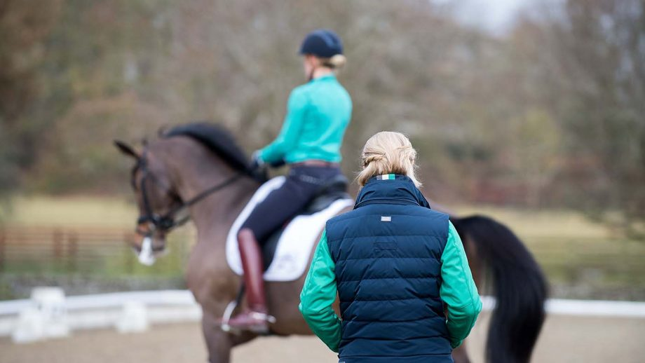 LAURA TOMLINSON LOOKS ON WITH Lara Griffith - Eastington Stables, Ampney St Peter, Gloucestershire, United Kingdom - 21 December 2016