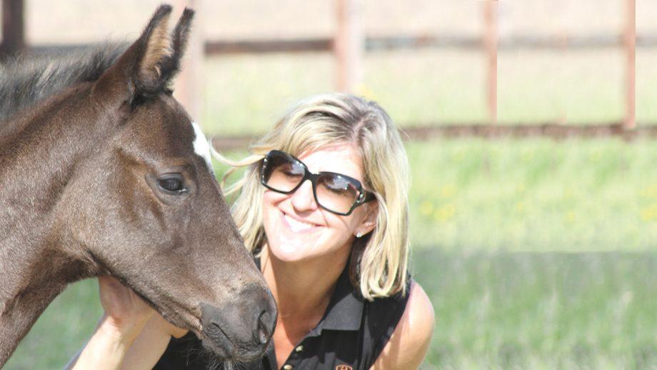 Sara Longworth with a Waverley Stud foal.