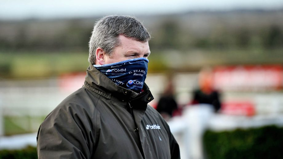 The British Horseracing Authority has temporarily banned Gordon Elliott from having runners in Britain, pending an investigation into a photo of him sitting on a dead horse