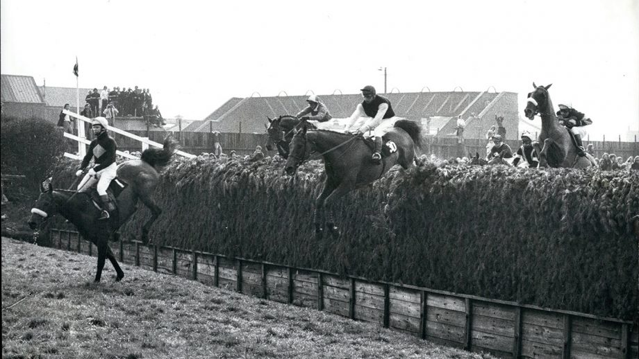 E10T8M Mar. 03, 1974 - Red Rum Wins His Second Successive Grand National At Aintree Today: Red Rum, ridden by jockey Brian Fletcher, today won the Grand National for the second successive year running. He become the first horse complete the double in 38 years. Phot Shows Red Rum, ridden by Fletcher clears Bachers Brook for the second time round, followed by Charles Dickens, ridden by A. Turnell (No. 30) who wa third and L'escargot, ridden by T. Carberry (extreme right) who finished second.