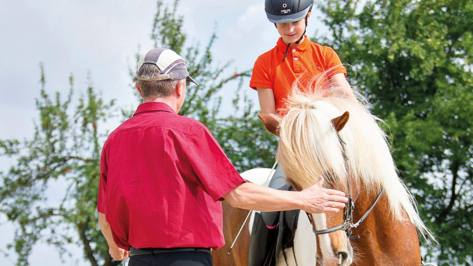 TA789K Icelandic Horse. A riding instructor gives a girl lessons. Austria