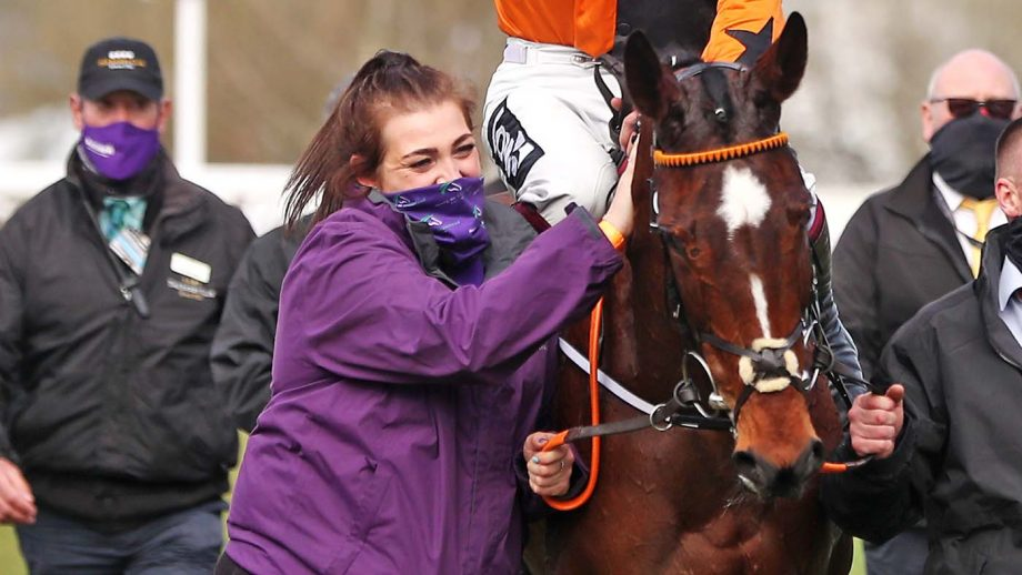 Irish racehorse trainer Henry de Bromhead's travelling head lass Zoe Smalley