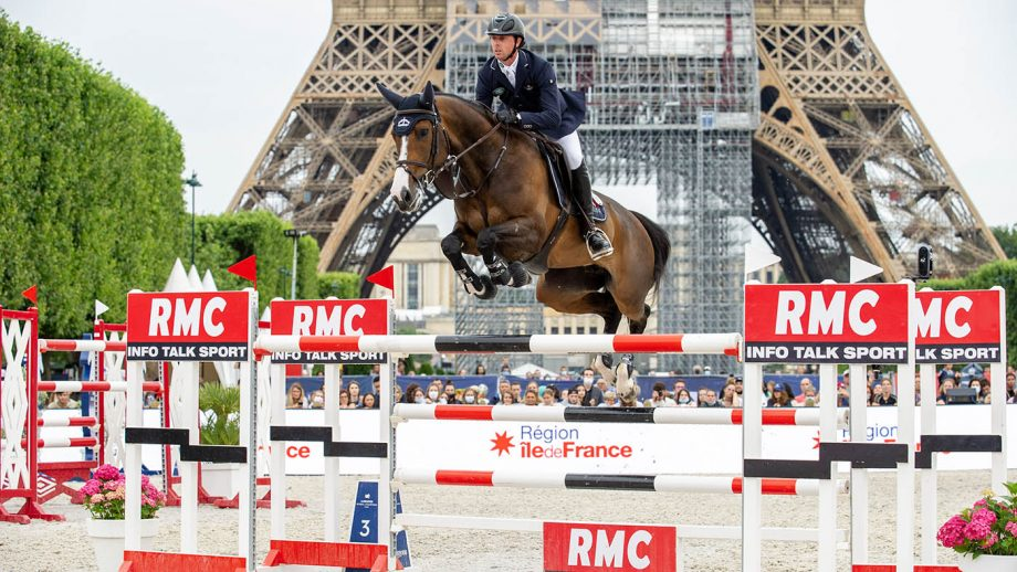 Ben Maher pictured in jumping Ginger Blue in front of the Eiffel Tower on his way to winning the Longines Global Champions Tour of Paris