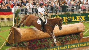 2E8DTFW Britain's Zara Phillips on Toytown jumps the water jumps during the cross country portion of the Eventing competition at the World Equestrian Games in Aachen August 26, 2006. REUTERS/Caren Firouz (GERMANY)