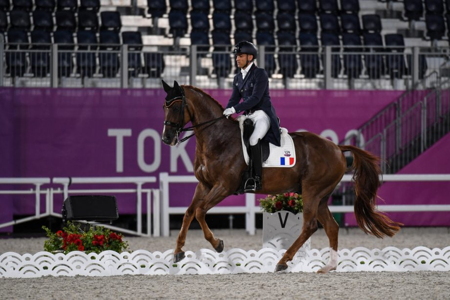 French dressage rider Alexandre Ayache and Zo What compete in the grand prix at the Tokyo Olympics
