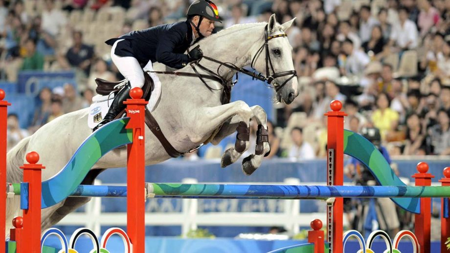 German rider Hinrich Romeike and his horse Marius clear a fence to win two gold medals in the Olympic eventing competition at the Beijing 2008 Olympic Games in Hong Kong.