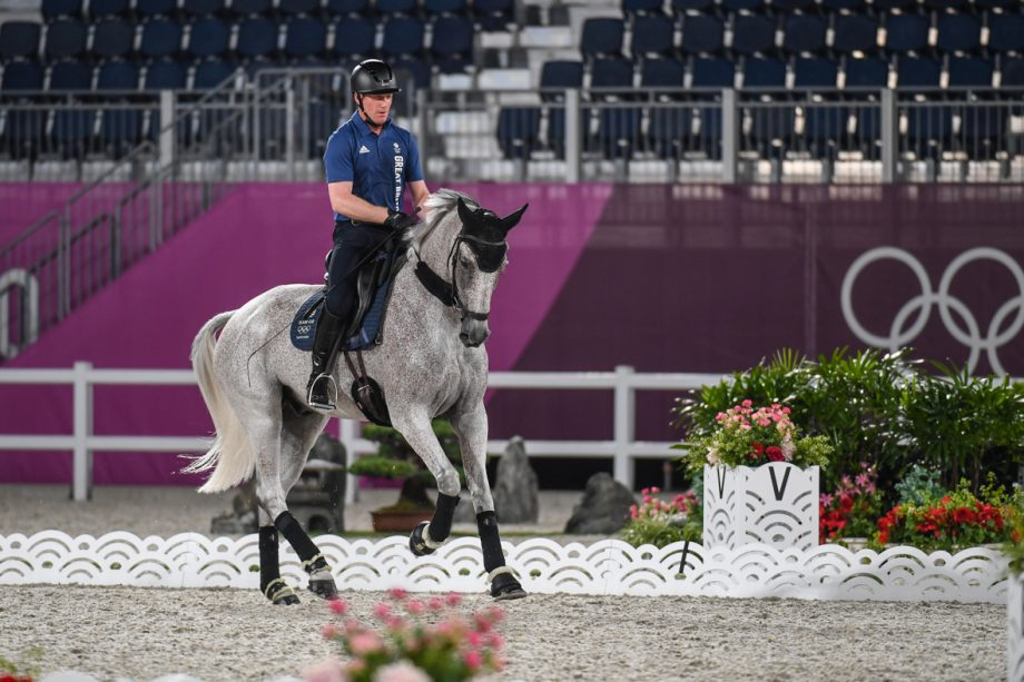 Olympic eventing dressage test: Olympic event horses in Tokyo: Oliver Townend and Ballaghmor Class during arena familiarisation
