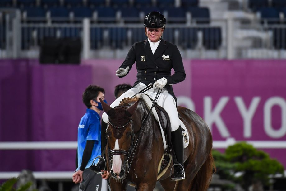 Isabell Werth pats Bella Rose 2 after their grand prix ride at the Tokyo Olympic dressage
