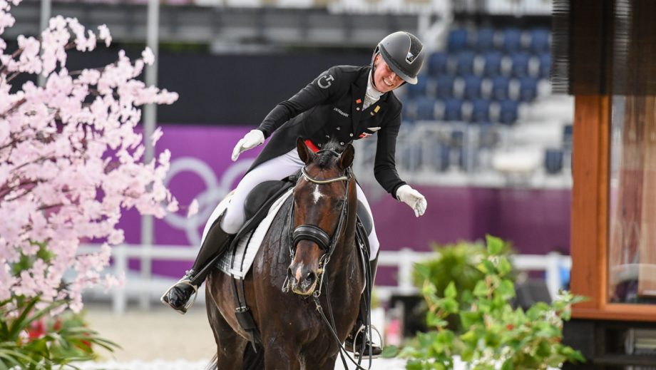 Nanna Skodborg Merrald pats Zack after finishing the grand prix special at the Tokyo Olympic dressage competition