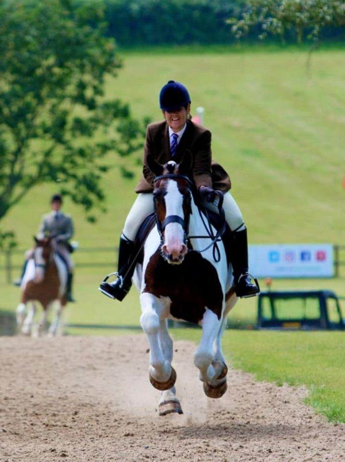 Natalie Chapples' maxi cob Aughoo Lad gallops up the Hickstead hill at the Royal International for the last time