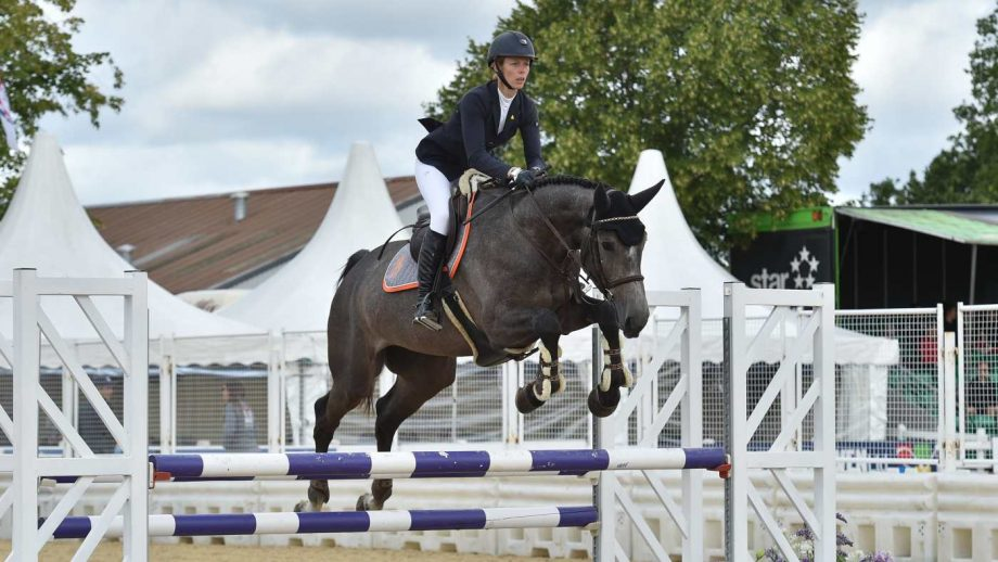 Jessica Botham and Clayton win the national four-year-old final at the British Showjumping national championships