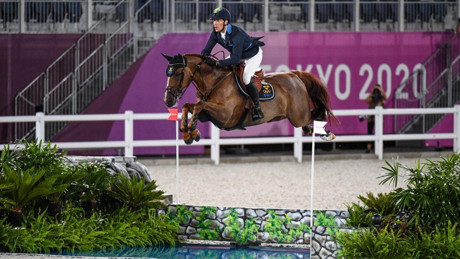 Sweden's Henrik von Eckermann riding King Edward in the Olympic team showjumping final at Tokyo 2020