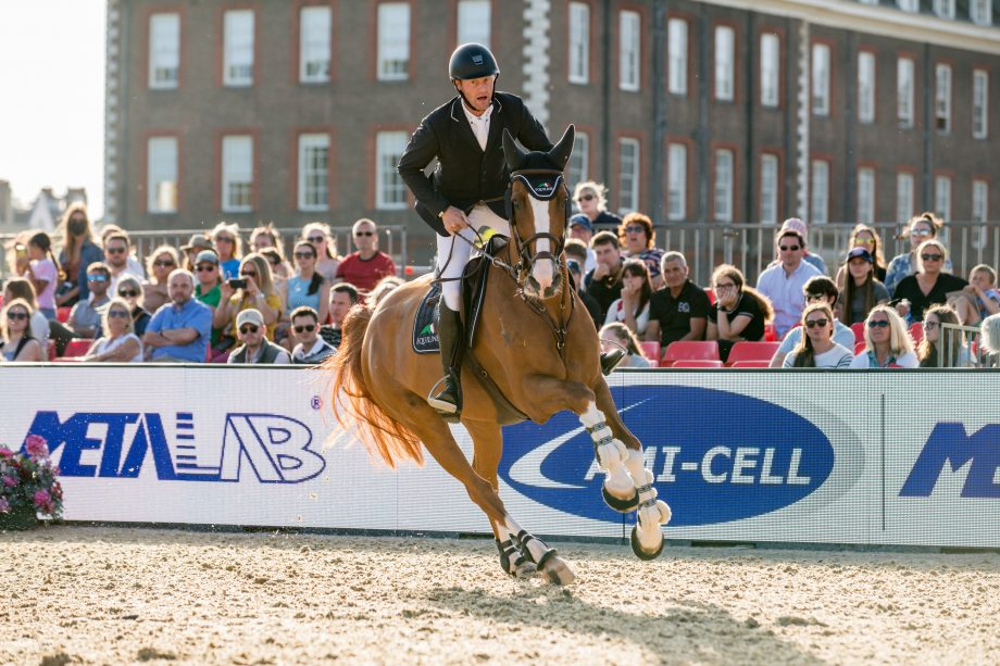 Niels Bruynseels and Ilusionata Van't Meulenhof jumping to third place in the grand prix at the London GCT