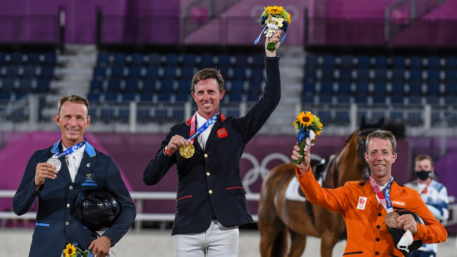 Ben Maher, Peder Fredricson and Maikel van der Vleuten celebrate on the podium after the Olympic showjumping individual final