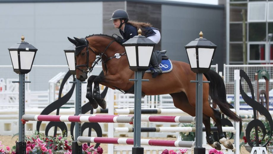 Olivia Sponer and Conella II win the pony discovery championship final the the British Showjumping national championships 2021