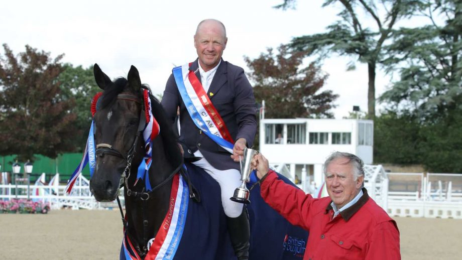 Adrian Speight and Millfield Baloney being congratulated on their British showjumping national championship win by David Broome