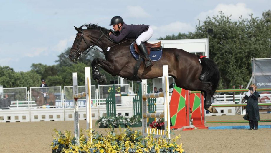 Adrian Speight and Millfield Baloney jump to victory in the international stairway final at the British Showjumping national championships
