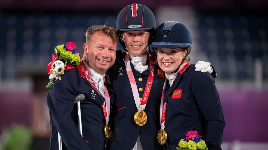 The British team with their gold medals on the podium after the Paralympic dressage team competition at the Tokyo Paralympic Games