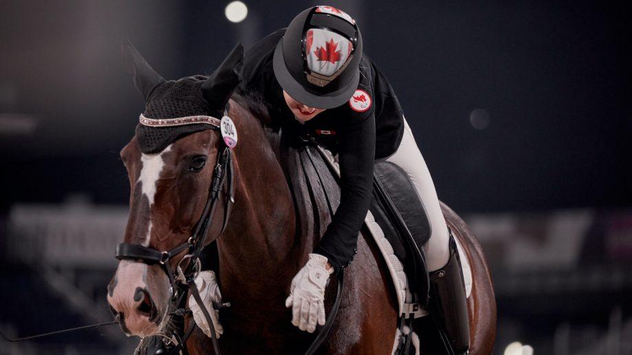 Tokyo Paralympic dressage: Bert Sheffield hugs Fairuza, after scoring 72% in the team test