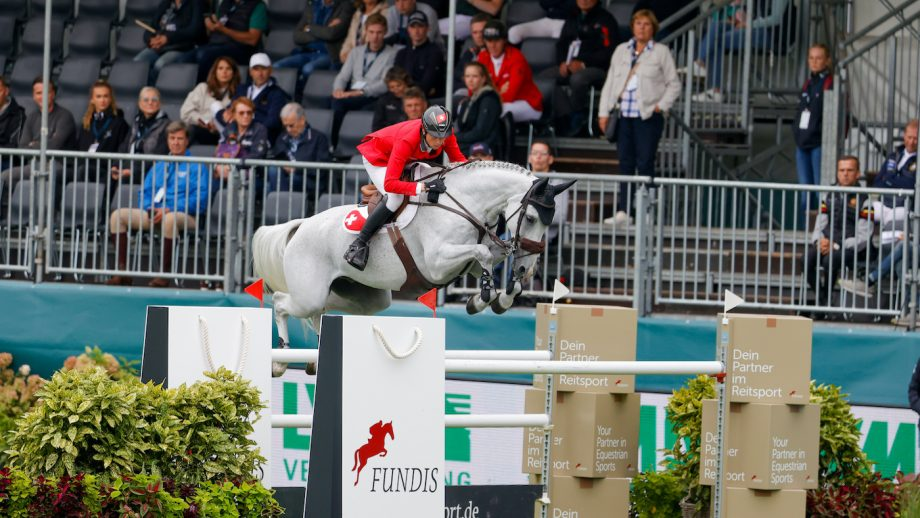 Martin Fuchs riding Leonie Jei in the European Showjumping Championships first round competition.