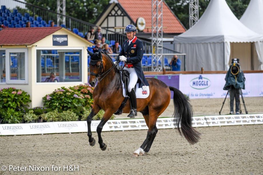 Gareth Hughes and Sinatano van Hof Olympia competing at Hagen in the European dressage championships grand prix