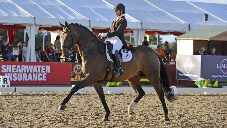 Becky Moody rides Jagerbomb to victory in the seven year old young horse championship at the Lemeiux National Dressage Championships.