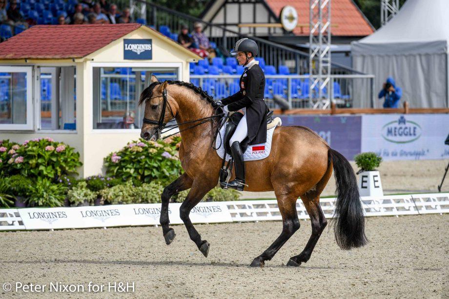 Katarzyna Millczarek riding Guano Guapo, the buckskin dressage horse, at the European Dressage Championships in Hagen, Germany