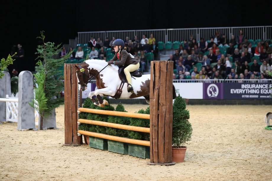 Captain Foley and Florence Drewitt jump to the 133cm working hunter pony title at HOYS