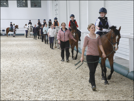 The children enjoy their riding lesson at Aintree International Equestrian Centre