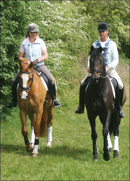Carl Hester and Pippa Funnell relax on a hack