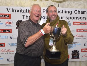Mark Williams hopes to repeat this scene at Gold Valley... collecting the PDC Fishing cup from Barry Hearn.