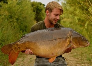 Jake Wright displays the impressive 55 lb Ashmead specimen, known as Single Scale.